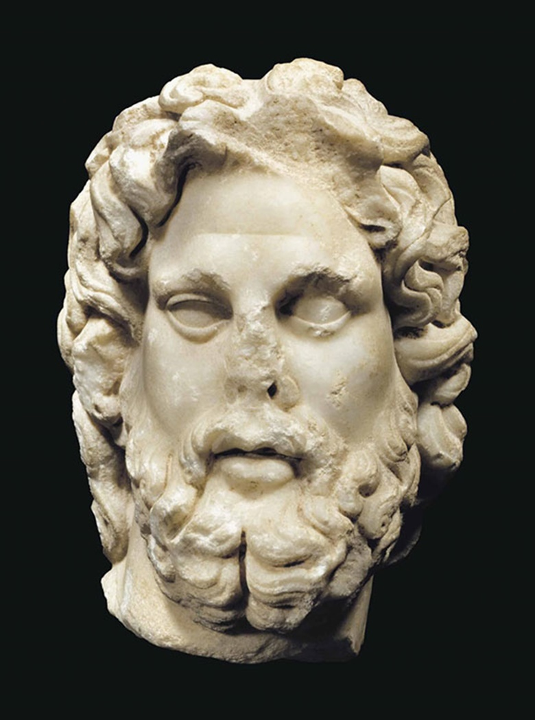 A Roman marble head of Asclepius. C. late 1st-early 2nd century AD. 8⅜ in (21.3 cm) high. This lot was offered inAntiquitieson 25 October 2016 at Christie's in New York and sold for $30,000