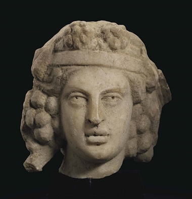 A Roman marble head of Bacchus. Circa 2nd century AD. 4⅜ in (11.1 cm) high. This lot was offered inAntiquitieson 25 October 2016 at Christie's in New York