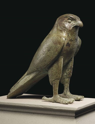 An Egyptian bronze falcon. Late period to Ptolemaic Period, 664-30 BC. 4⅞ in (12.4 cm) high. This lot was offered inAntiquitieson 25 October 2016 at Christie's in New York and sold for $75,000
