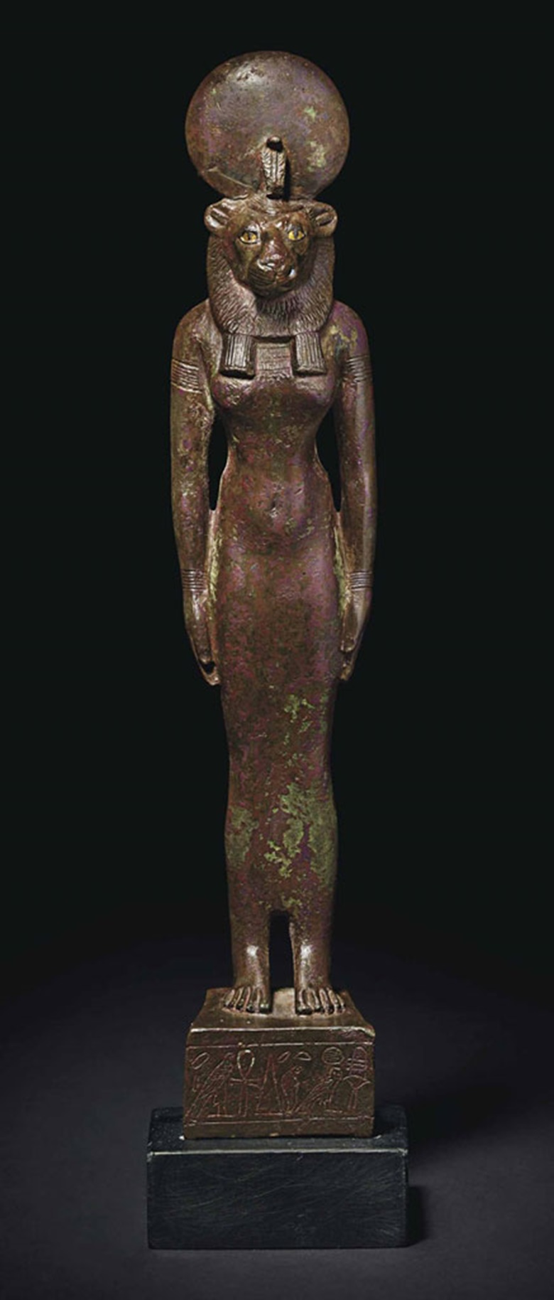 An Egyptian bronze Sekhmet. Third Intermediate Period, c.  1069-664. 10¾ in (27.3 cm) high. This lot was offered inAntiquitieson 25 October 2016 at Christie's in New York and sold for $247,500