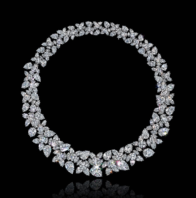 A diamond cluster necklace, by Harry Winston and a photograph, by Cecil Beaton. This lot was offered in Magnificent Jewels on 7 December 2016 at Christie's in New York and sold for $1,027,500