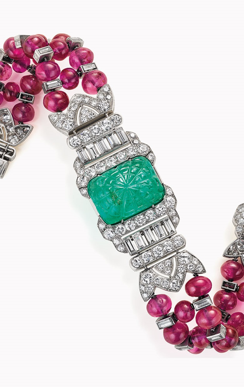 An Art Deco emerald, ruby and diamond bracelet, by Oscar Heyman & Brothers. This lot was offered in Magnificent Jewels on 7 December 2016 at Christie's in New York and sold for $223,500