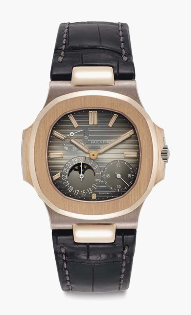 Patek Philippe. An 18k pink and white gold automatic wristwatch with moon phases, date, and power reserve. Signed Patek Philippe, Genève, retailed by Tiffany & Co., Nautilus Model, Ref. 5712GR, Movement No. 5570879, Case No. 4530649, Manufactured in 2006. This lot was offered in Rare Watches including NAUTILUS 40 part IV on 6 December 2016 at Christie's in New York and sold for
