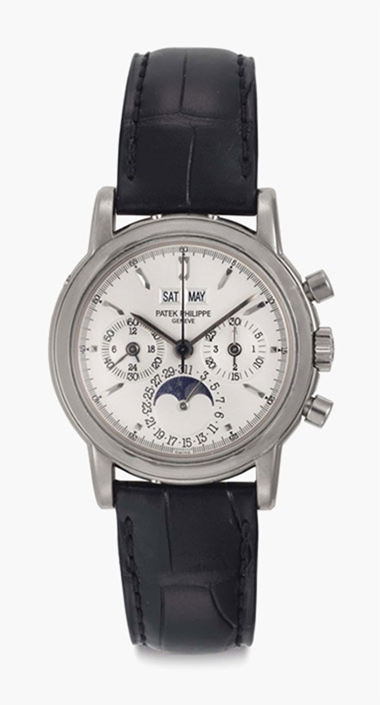 Patek Philippe. A fine 18k white gold perpetual calendar chronograph wristwatch with moon phases and additional solid caseback. Signed Patek Philippe, Genève, Ref. 3970EG, Movement No. 3046687, Case No. 4197762, Circa 2003. Estimate $70,000-100,000. This lot was offered in Rare Watches including NAUTILUS 40 part IV on 6 December 2016 at Christie's in New York and sold for $80,000