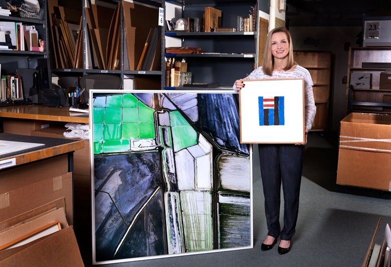 Anne Bracegirdle, Photographs specialist, holds Untitled, 1982, by Sean Scully, alongside David Maisel's Terminal Mirage 5, created in 2003