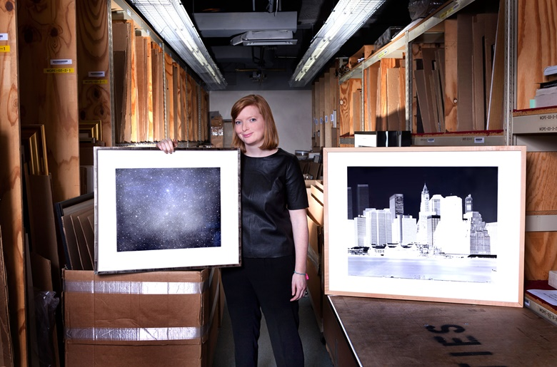 Lindsay Griffith, Prints specialist, with her choice of Night Sky 3, 2003, by Vija Celmins, alongside Fulton Ferry Landing, Manhattan Skyline, Brooklyn, New York, June 1996, by Vera Lutter, from 1996