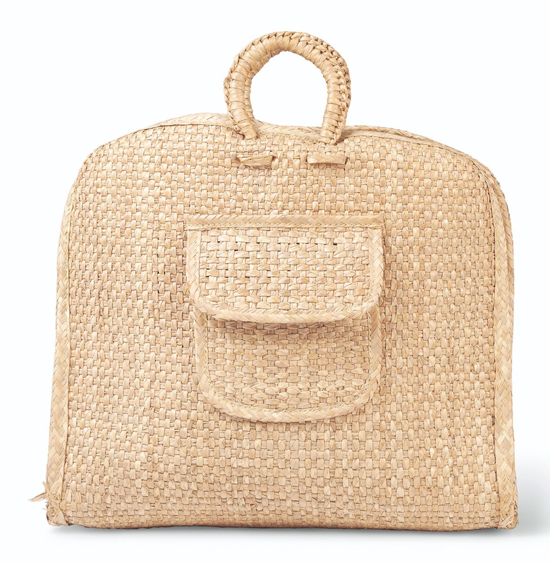 A large straw satchel, Circa 1960. Estimate £800-1,200. This lot is offered in Audrey Hepburn The Personal Collection on 27 September 2017  at Christie's in London. Audrey Hepburn is photographed in France with what is almost certainly this straw tote bag on a sunny day in May 1960, with her husband, Mel Ferrer, carrying it.