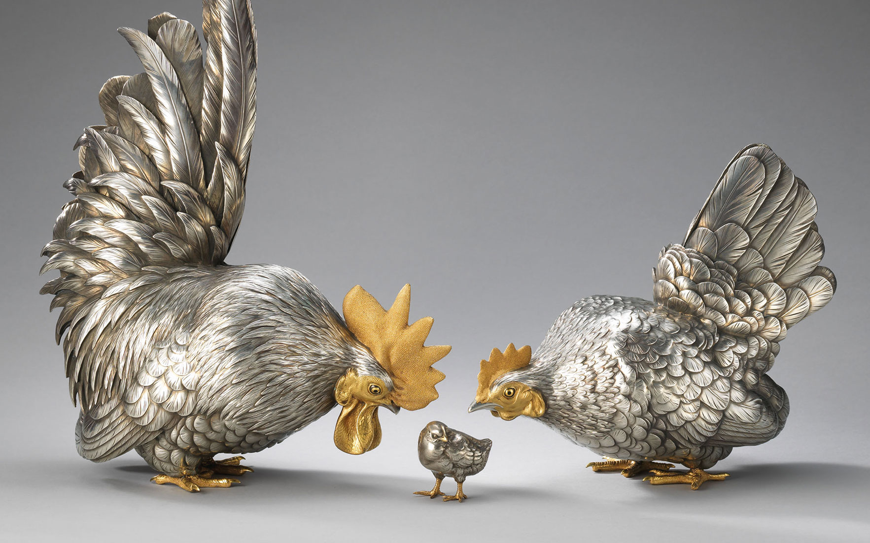 A set of silver models of a rooster, hen and chick, Meiji period, late 19th century. Rooster 16⅛  in (41  cm) high, Japanese wood box. This lot was offered in the Pavilion Sale on 2 October 2017