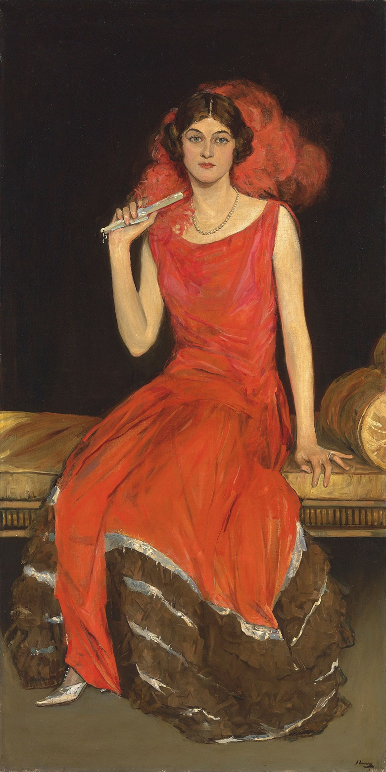 Sir John Lavery, R.A., R.S.A., R.H.A. (1856-1941), Lady in Red, Mrs Owen Barton Jones. 72 x 36¼  in (183 x 92  cm). Estimate £450,000-650,000. This lot is offered in the British Impressionism Evening Sale on 22 November at Christie's in London