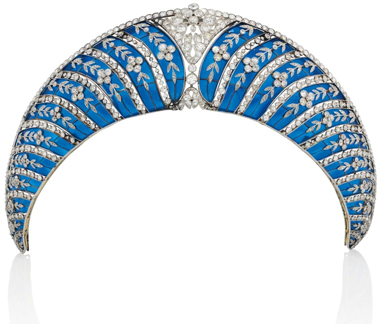 A Belle Époque enamel and diamond tiara, by Chaumet. Of kokoshnik design, composed of a series of graduated translucent royal blue plique-à-jour enamel curved panels, each overlaid with old-cut diamond trailing forget-me-not floral motifs, interspersed with collet-set diamond lines, to the cushion-shaped diamond openwork cartouche centre and similarly-set upper border, circa 1910,