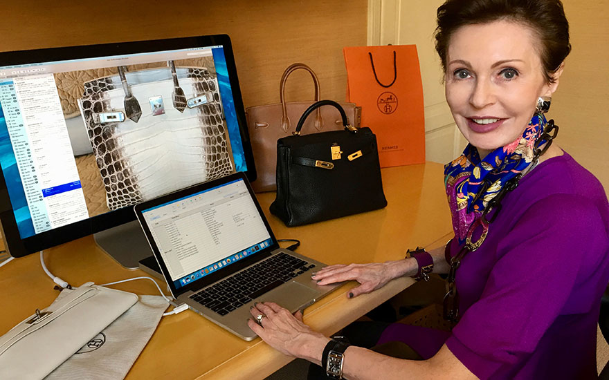 Dimity Giles, authenticating a luxury handbag for one of her clients