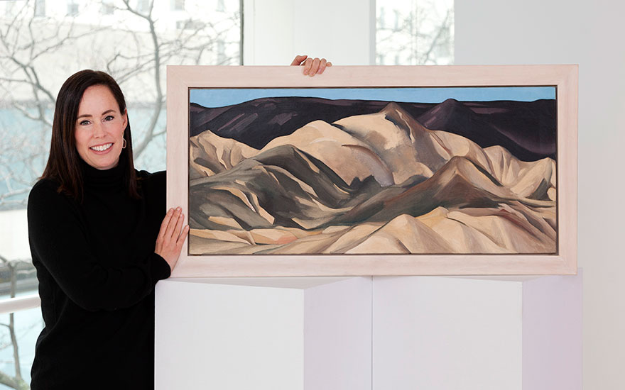 Elizabeth Beaman, Christie's Senior Director of American Paintings, with Georgia OKeeffe's Near Abiquiu, New Mexico (1931) © 2018 Georgia OKeeffe Museum  Artists Rights