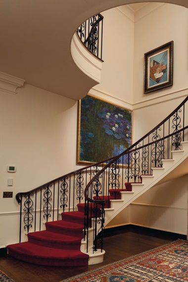 Claude Monet's Water Lilies (Nymphéas) hanging in the stairwell at Hudson Pines, with La table du musicien by Juan Gris above it