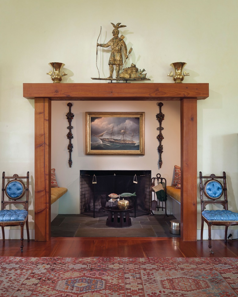 A molded and gilt-copper Massasoit Indian weathervane displayed on the mantel at Four Winds in Columbia County, New York