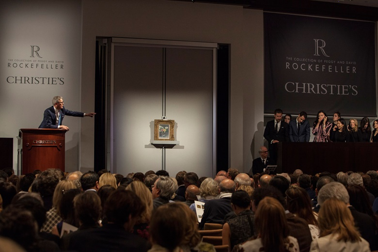 A packed New York saleroom during an historic week of sales of The Collection of Peggy and David Rockefeller