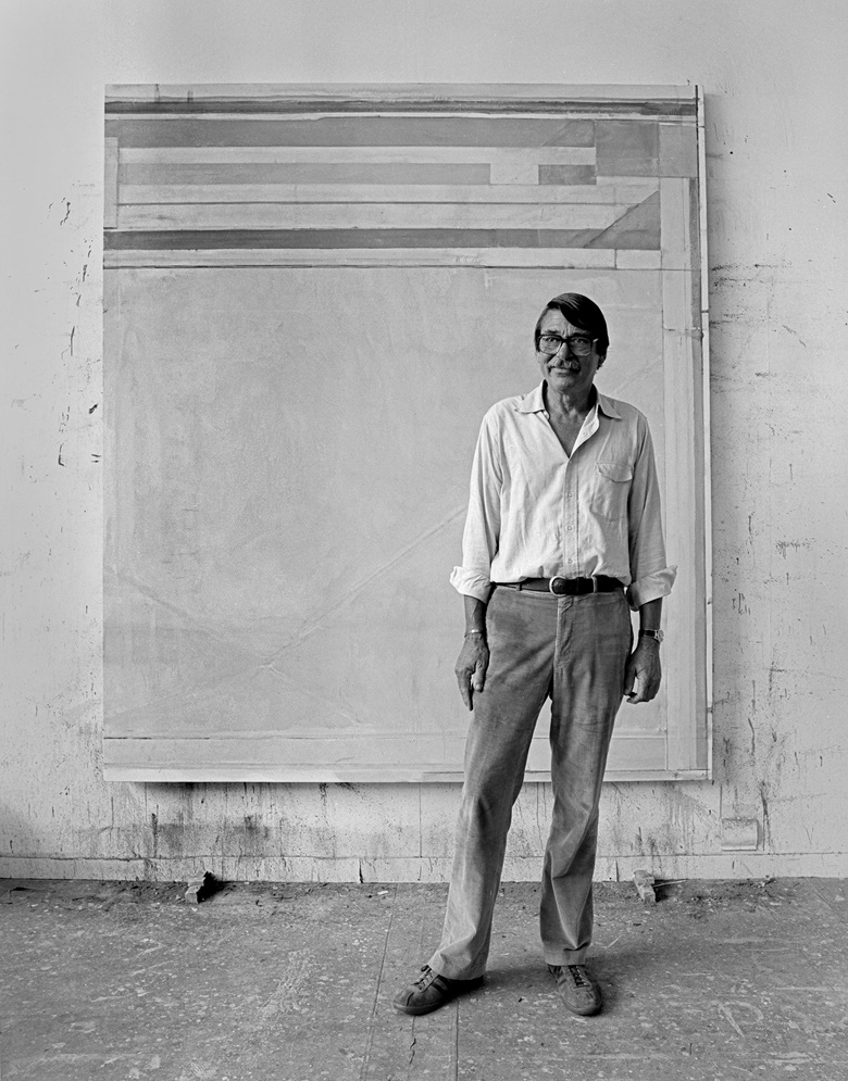 Richard Diebenkorn photographed in his studio in Ocean Park, Santa Monica, in 1980. Photo by Kurt Edward Fishback © 1980.  Artwork Richard Diebenkorn, Ocean Park #123, 1980, oil on canvas, 93 x 81 in. (236.2 x 205.7 cm). [Catalogue raisonné no. 4432] © Richard Diebenkorn Foundation