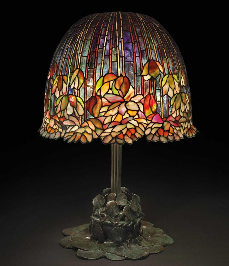 Tiffany Studios. A rare and important 'Pond Lily' table lamp, circa 1903. Leaded glass, patinated bronze. 26½ in (67.3 cm) high, 18 in (45.7 cm) diameter of shade. Shade impressed TIFFANY STUDIOS NEW YORK, base impressed TIFFANY STUDIOS NEW YORK 29555. Estimate $1,800,000-2,500,000. Offered in the Design Sale at Christie's on 13 December at Christie's in New York