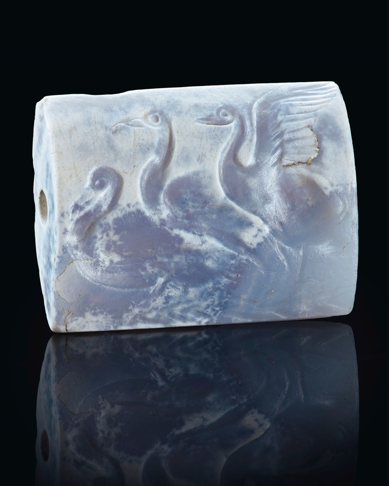 A Minoan blue chalcedony tabloid seal with three swans, Late Palace period, circa 16th century BC. ¾in (1.9  cm) long. Sold for $118,750 on 29 April 2019 at Christie's in New York