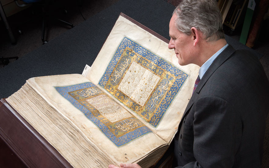 William Robinson with a half-Baghdadi-sized royal Mamluk Qur'an. Offered in Art of the Islamic and Indian Worlds Including Oriental Rugs and Carpets on 2 May 2019 at Christie's in London