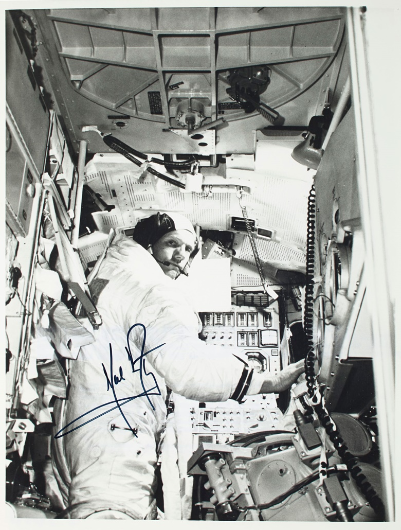 A signed photograph of Commander Neil A. Armstrong aboard a lunar module simulator, taken about a month before the Apollo 11 mission. Sold for $18,750 on 18 July 2019 at Christie's in New York