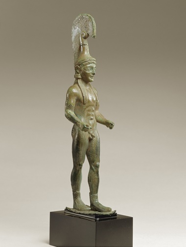 A Greek bronze youth in helmet and boots, circa 520 BC, 19.6 cm high, from the Ortiz Collection