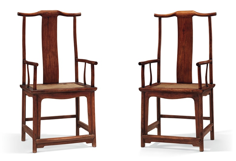 A pair of huanghuali  'officials hat' armchairs, sichutouguanmaoyi, 18th century. 45¼ in (114.9 cm) high, 23⅛ in (58.7 cm) wide, 18⅞ in (47.6 cm) deep. Estimate $180,000-250,000.  Offered in Important Chinese Ceramics and Works of Art on 13 September 2019 at Christie's in New York