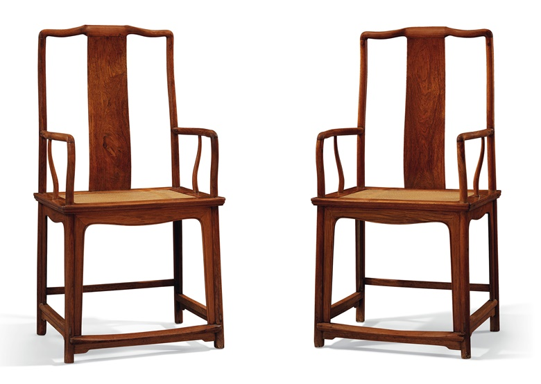 A rare pair of huanghuali  'southern official's hat' armchairs, nanguanmaoyi. 17th-18th century. 45 in (114.3 cm) high, 23¼ in (59 cm) wide, 18 in (45.7 cm) deep. Estimate $150,000-250,000. Offered in Important Chinese Ceramics and Works of Art on 13 September at Christie's in New York