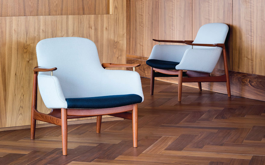 Finn Juhl (1912-1989), A pair of armchairs, Model No. FJ53, designed 1953. Teak, upholstery, brass executed by master cabinetmakers Niels Vodder, Copenhagen, Denmark. Each 29 x 28 ¾ x 31