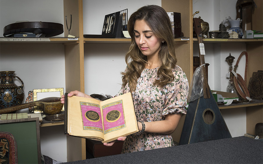 Christie's Islamic Art specialist Behnaz Atighi Moghaddam with a richly illuminated royal prayer book dated to 1873