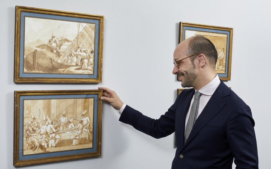 Old Master Drawings specialist Stijn Alsteens with a group of Giovanni Domenico Tiepolo's Punchinello drawings at Christie's