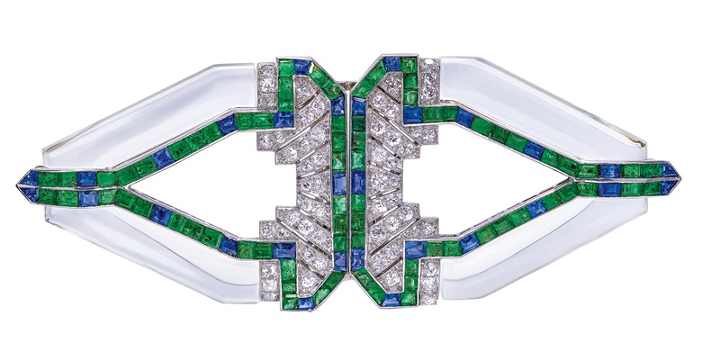 Raymond Yard, Art Deco rock crystal, emerald, sapphire and diamond double clip brooch, 1930s. Rock crystal, calibré-cut emeralds and sapphires, old-cut diamonds, detachable to wear as two clip brooches, 9.0 cm. Sold for CHF 30,000 on 12 November 2019 at Christie's in Geneva