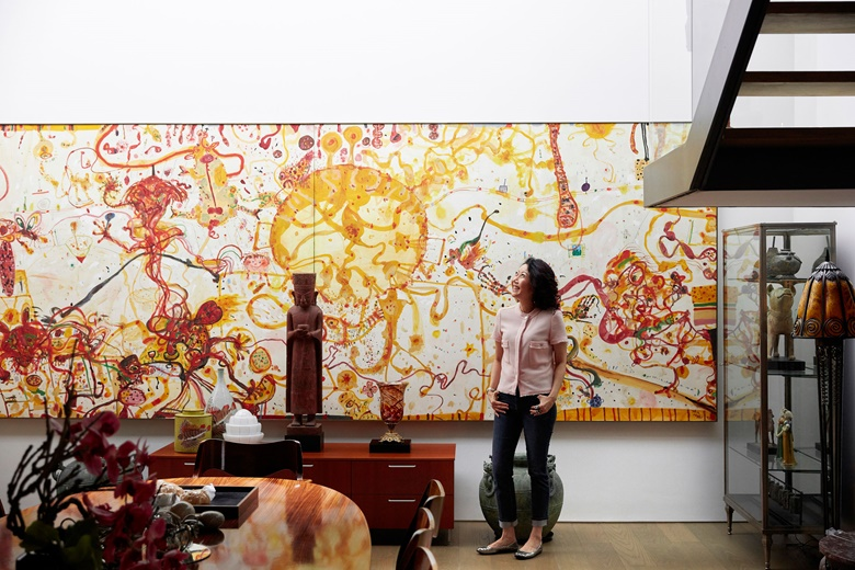 Erica Lai with a partial view of John Olsen, The Tuscan Kitchen, 1992. Artwork © John Olsen, DACS 2019