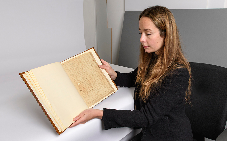 Christie's Books and Manuscripts specialist Sophie Hopkins with a copy of the Ireland Shakespeare forgeries. Offered in Shakespeare and Goethe Masterpieces of European Literature from the