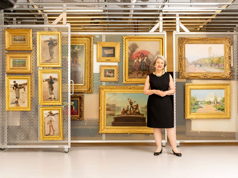 The foundation's president and CEO Elizabeth Glassman with 19th-century works owned by the Terra Foundation. Photograph David Kasnic