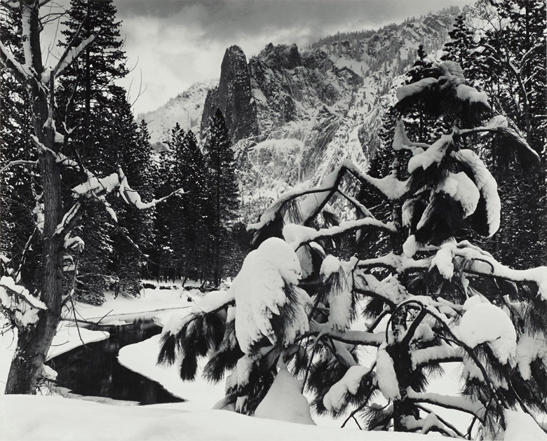 Ansel Adams (1902–1984), Sentinel Rock, Winter Dusk, Yosemite National Park, California, 1944. Gelatin silver print, mounted on board signed in pencil (mount, recto); signed and inscribed 'From Portfolio II' in pencil (mount, verso). Mount 14 x 17⅞ in (35.6 x 45.4 cm). Estimate $4,000-6,000. Offered in Ansel Adams and the American West Photographs from the Center for Creative