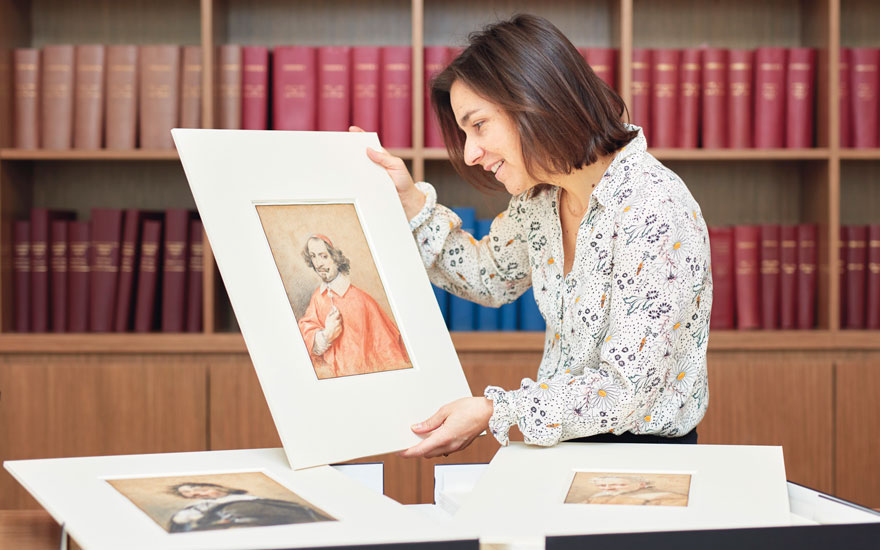 Christies Old Master Drawings specialist Hélène Rihal with three portraits by Simon Vouet