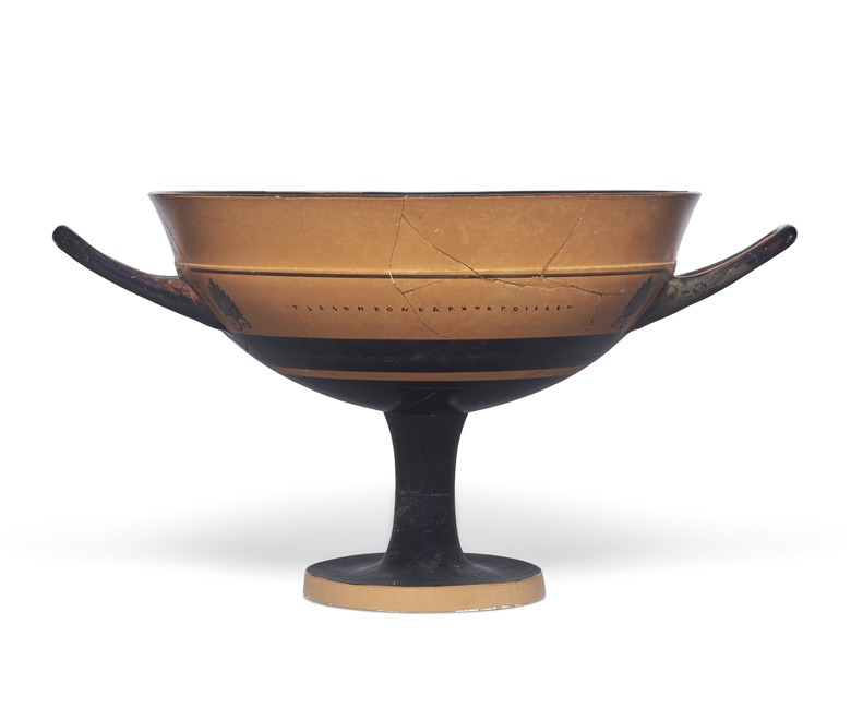 An Attic black-figured lip-cup, signed by Tleson as Potter and attributed to the Tleson Painter, circa 540 BC. 8 in (20.3 cm) diameter, excluding handles. Estimate $8,000-12,000. Offered in Antiquities on 2-16 June 2020 online