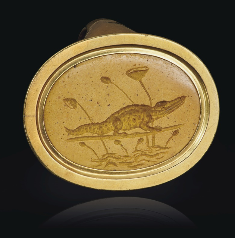 A Greek yellow jasper ringstone with a crocodile, Alexandria, Hellenistic Period, circa 2nd-1st century BC. ¾ in (1.9 cm) long. Sold for $75,000 on 16 June 2020, Online