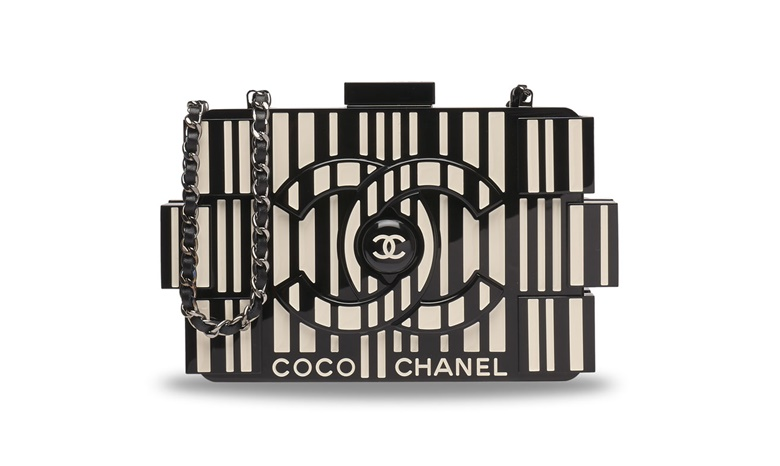 A runway black & white lucite lego clutch bag with silver hardware, Chanel, 2014. Estimate HK$30,000-$40,000. Offered in Handbags & Accessories at Christie's in Hong Kong
