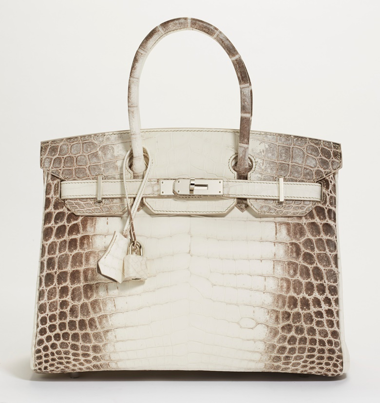 A rare, matte white Himalaya Niloticus Crocodile Birkin 30 with palladium hardware, Hermès, 2019. 30 w x 22 h x 15 d cm. Estimate $80,000-100,000. Offered in Handbags & Accessories Online on 28 July 2020 at Christie's in New York.