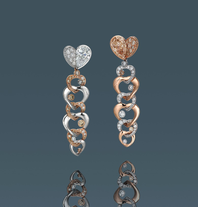 A pair of fancy colour diamond and diamond earrings designed by Anna Hu. Estimate HK$200,000-300,000. Offered in Diamonds that Care, 3-13 July 2020, Online