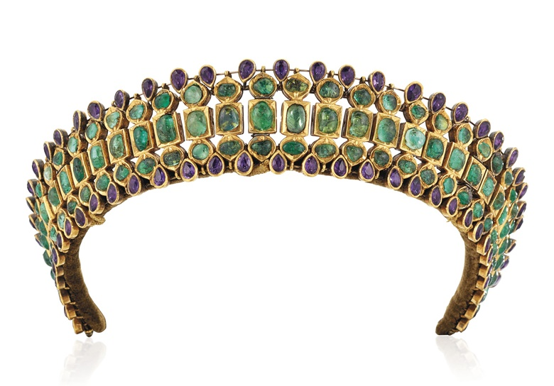 Late 19th-century emerald and amethyst tiara. Cabochon and flat-cut emeralds, pear-shaped amethysts, closed-back settings, silver and gold, circa 1890, velvet-covered tiara frame, 3.8 cm high, purple fitted case. Estimate £8,000-12,000. Offered in Important Jewels on 30 July 2020 at Christie's in London
