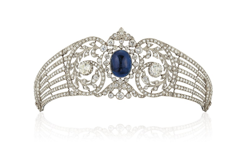 Belle Epoque sapphire and diamond tiara. Cabochon sapphire, rose and old-cut diamonds, circa 1910, 17.0 cm, blue fitted Sanz case. Estimate £15,000-25,000. Offered in Important Jewels on 30 July 2020 at Christie's in London