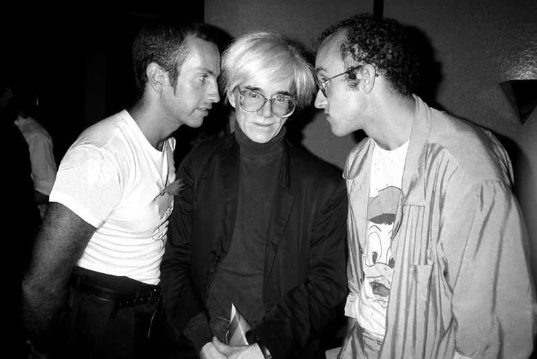 Kenny Scharf, left, his mentor Andy Warhol and close friend Keith Haring at Elizabeth Saltzman's birthday party at Il Cantinori on 16 June, 1986. Photo Patrick McMullanGetty Images