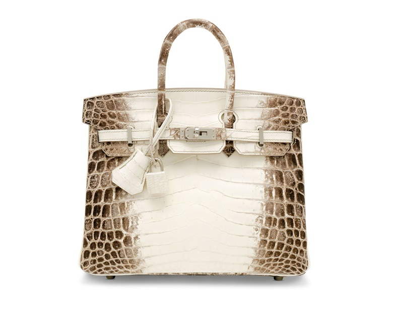 A rare, matte white Himalaya Niloticus crocodile Birkin 25 with palladium hardware, Hermès, 2020. 25 x 19 x 14 cm. Estimate £60,000-80,000. Offered in Handbags & Accessories Online The London Edition, 3-17 November 2020, Online