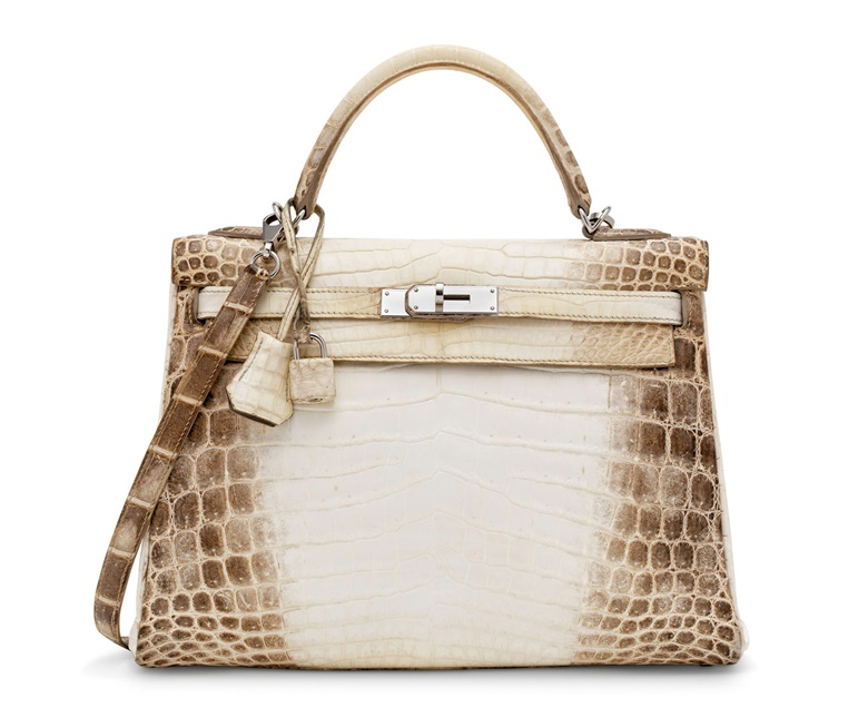 A rare, matte white Niloticus crocodile Retourné Kelly 32 with palladium hardware, Hermès, 2014. 32 w x 23 h x 10 d cm. Estimate £40,000-60,000. Offered in Handbags & Accessories Online The London Edition, 3-17 November 2020, Online